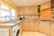 Kitchen of pre-owned park home for sale on Burlingham Park Garstang